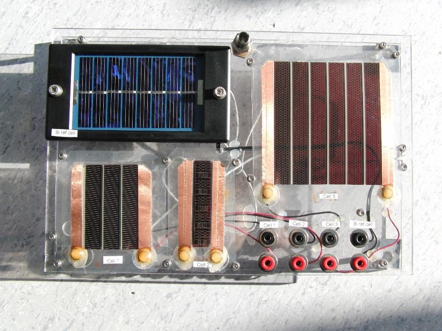 Figure 1: Three OPV modules and one Si reference module fixed on a rigid platform The compact suitcase (36 x 29 x 17 cm) used for sample transportation was customized to serve also as a sample holder