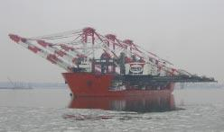 HEAVY LIFT Heavy lift shipping hangs on Fully (or near fully) erect transport remains the preferred method of shipping ship-to-shore container cranes, but demand for new cranes slipped last year.