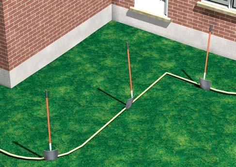 Prepare The Base Use a garden hose to mark the location of the wall. Remove the sod and other surface material.