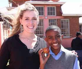 Handing out apples An apple a day keeps the doctor away. HORTGRO supports fundraiser HORTGRO s new Events Coordinator, Thea Visser, with a smiling pupil from Dryden Primary School.