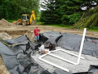 The filter is comprised from top to bottom of: a 0.2 m layer of Sphagnum peat moss, a 0.4 m layer of 1-5 mm washed sand, a 0.2 m drainage layer of 13-20 mm washed gravel and a 30 mil PVC liner.