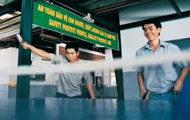 Nguyeãn Thanh Tuaán and Nguyeãn Vaên Tuaân at the Dong Nai factory in Vietnam, keeping fit in their lunchbreak by playing table tennis.