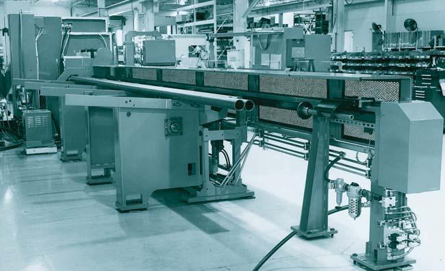 Automatic loading tables keep stock in the machines at all times, which lets one operator run more than one machine.