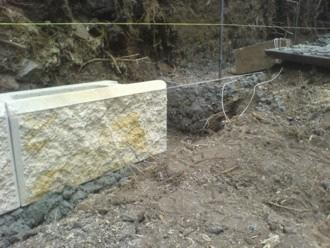 Footing poured - vertical steel rods and steps showing This footing was excavated to 400mm wide x 300mm deep.