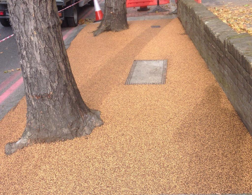 FEATURES SuDS compliant highly permeable UV stable non yellowing resin includes recycled rubber granules alternative to tree grilles installed by approved contractors