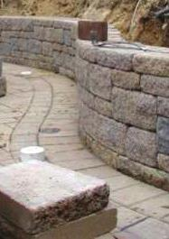 If you are building on unlevelled areas you can prepare step ups or step downs in increments of the thickness of the stone.