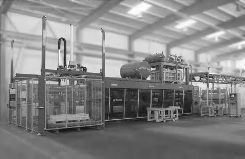 56 Chapter 8 Production of Refrigerator Liners Figure 8.3 Thermoforming machine (Courtesy of Kiefel GmbH) method.