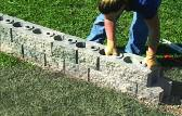 Installing the first two courses at the same time will ensure that the blocks line up properly.