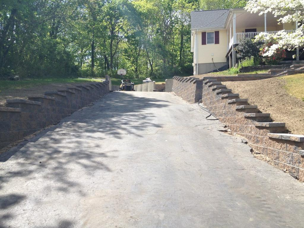 Place the backfill, leaving a minimum of 12 inches of space between the retaining wall unit and the backfill, for the drainage aggregate (1/2 to 3/4 angular gravel with a maximum of 5% fines).