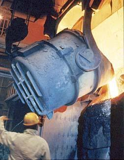 Basic Oxygen Furnace Steel Barrel lined with refractory material. Barrel pivots on a shaft and tips to one side so the molten scrap material molten iron from the blast furnace can be poured into it.