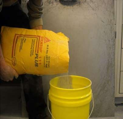 Mixing Add B (powder) Component to pail with