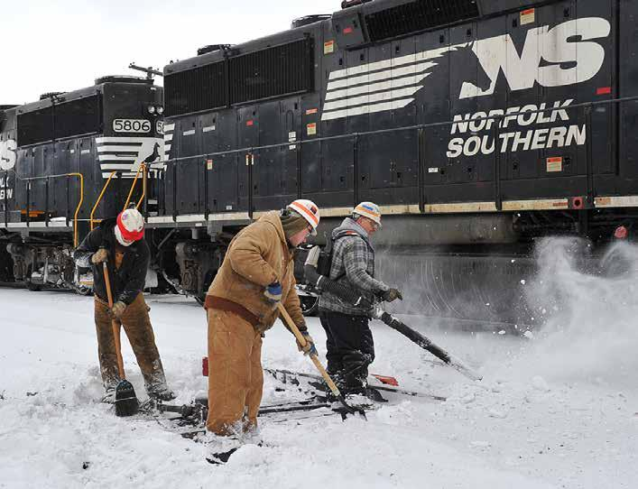 n A Norfolk Southern maintenance-of-way crew clears snow from track switches as a local NS train out of Altoona, Pa., arrives at an interchange yard in Hollidaysburg, Pa.