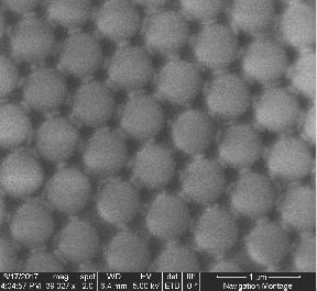 6) A Scanning Electron Microscope (SEM) image of polystyrene bead in hexagonal formation The spherical inclusion shape is the most promising of them to work with.