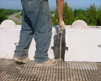 Place non-woven geotextile fabric in the vertical joint between the blocks to hold the backfill material between the blocks in place and prevent material from washing out through the joints between