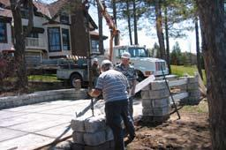 Install subsequent courses of column blocks. Use a concrete adhesive or mortar cement to fasten column blocks together.