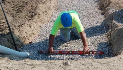 The leveling pad material should be placed and compacted to provide a uniform, level pad on which to construct the retaining wall.