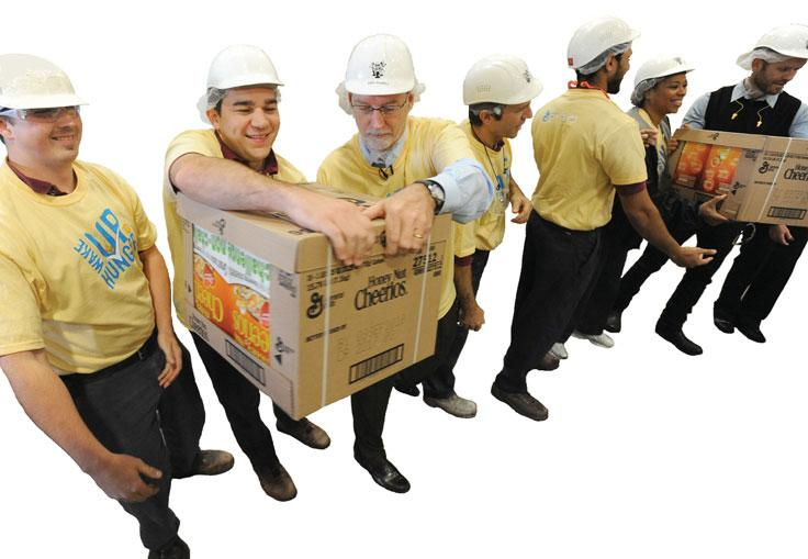 58 PART 1 INTRODUCTION l17/newscom In this photo, employees at a General Mills plant load boxes of cereal onto a community food bank truck as part of the company s commitment to Feeding America, a