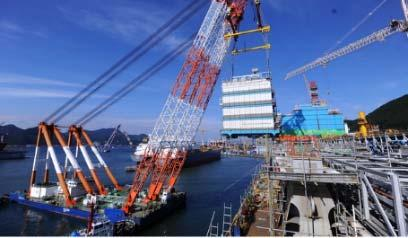 consortium with DSME FLNG towed to site