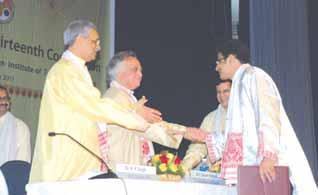 awardee at the 13th Convocation in the presence of Dr. R. P. Singh, Chairman, BoG (1L) and Prof. Gautam Barua, Director.