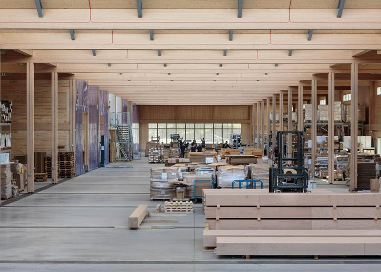 Source: Vitsœ The LVL roof beams, which weigh half a tonne, span the full 25m width of the factory Timber specialist Waugh Thistleton was hired but as executive architect.