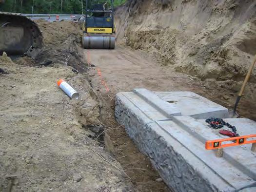 Preparing the Leveling Pad Using the grade stakes and elevation hubs, excavate the base course trench to a minimum depth of 6-inches and to a width that extends a minimum of 6-inches in front and