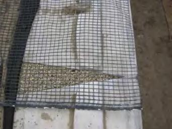 When placing backfill over a layer of geogrid, start just behind the drainage aggregate and fill toward the tail of the geogrid.