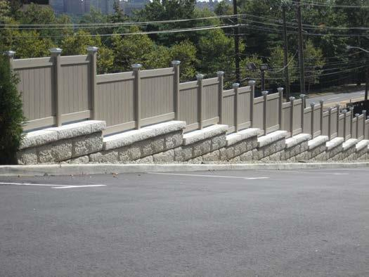 In the case of geogrid reinforced walls, installation of the sonotubes for the railing, fence or traffic barrier will be dependant on various site conditions.