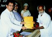 214 DARE/ICAR ANNUAL REPORT 2002 2003 Dr M P Yadav, Director (IVRI, Izatnagar), is receiving Sardar Pate Outstanding ICAR Institution award 2001 NG Ranga Farmer Award for Diversified Agricuture 2001