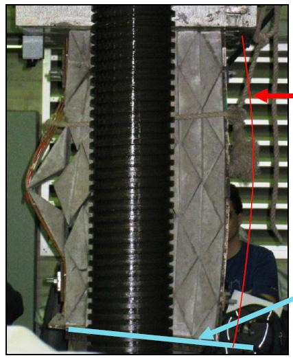 4 Loading of the concrete specimen reinforced with steel wire mesh showing displacement and rotation of the prisms. Fig.