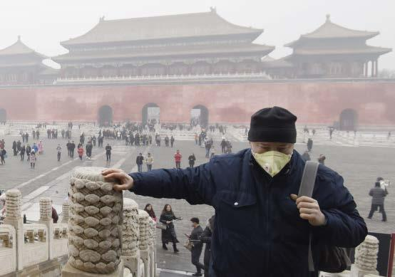 NEWS A person wears a mask to protect against heavy air pollution outside the Palace Museum in Beijing, China, on 5 January 2017.
