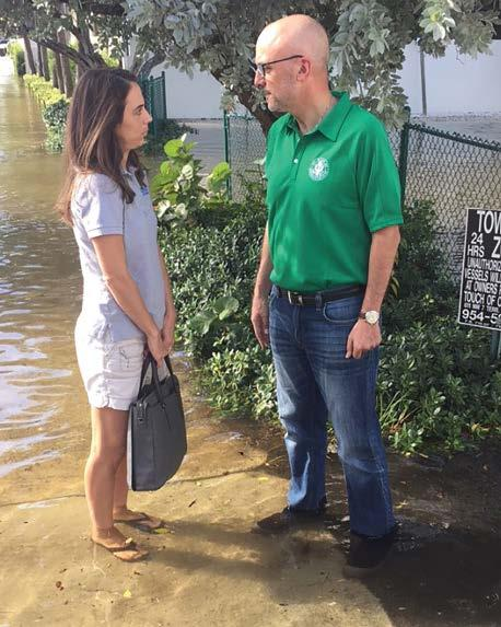Rep. Ted Deutch speaks with a constituent during king tide flooding in Fort Lauderdale, Fla., on 17 October 2016. Credit: Office of Rep.