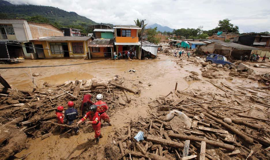 Rescuers search for survivors on 2 April 2017 after floodwaters carrying mud and debris inundated parts of Mocoa, Colombia, killing at least 200 people and leaving many more injured and homeless.