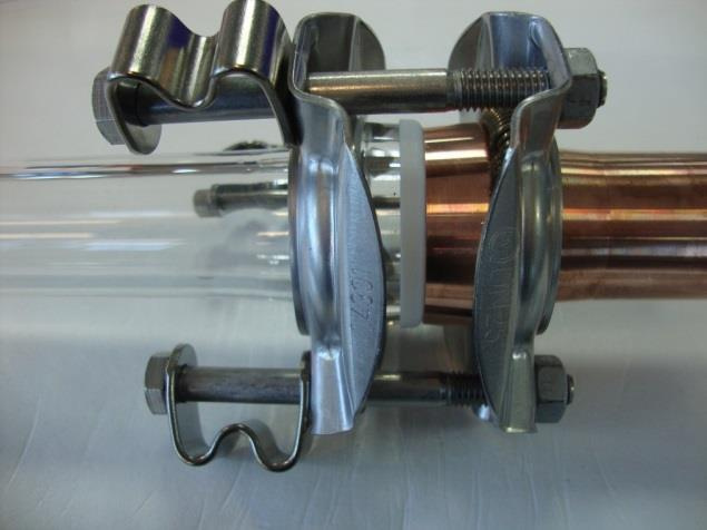 Mechanical attachment Two deep drawn stainless steel flanges, spring elements and necessary bolts and nuts PTFE