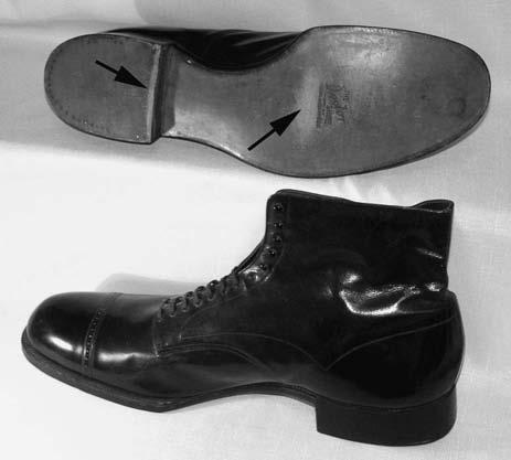 392 Friction Science and Technology: From Concepts to Applications FIGURE 9.17 These U.S.-sized 26 shoes are 0.44 m long and were custom-made for the 265 lb (120.