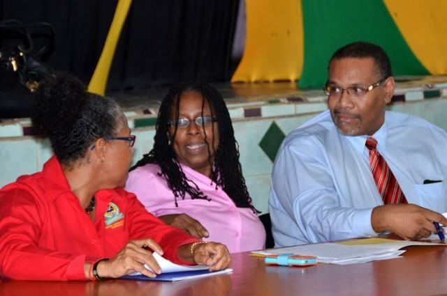 Overcoming Governance Deficit: Town Hall Meeting Mayor of Kingston, Senator Angela Brown Burke (centre); is in conversation with Parish Manager, Social Development Commission (SDC), Sandra Goulbourne